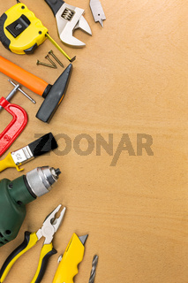 Assorted work tools on wood table