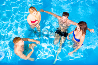 Young people having fun in the pool
