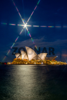 Sydney Opera house at night with moon