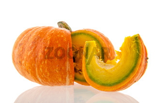 Whole pumpkin with cut slice