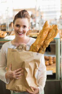 Pretty brunette with bag of bread