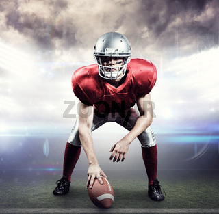 Composite image of american football player holding helmet
