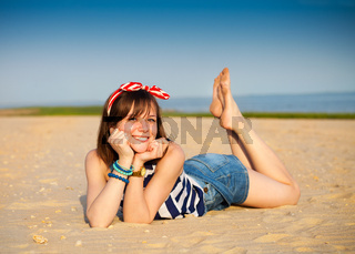 Portrait of the beautiful teen girl near the sea