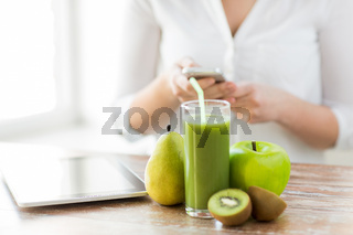 close up of woman with smartphone and fruits