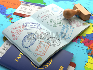 Travel or turism concept. Opened passport with visa stamps with airline boarding pass tickets and stamper on the world map.