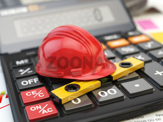 Constructions tools hardhat and level on calculator. Concept of calculation of  costs of construction.