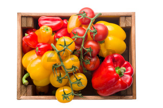 peppers and tomatoes in wooden box