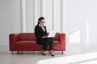 Business woman in office isolated on white