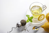 Green tea with mint and lemon with strainer top view