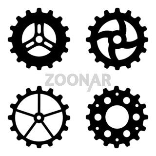 Four Black Gearwheels