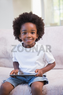 Portrait of a little boy using digital tablet