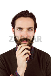 Hipster thinking with hand on chin