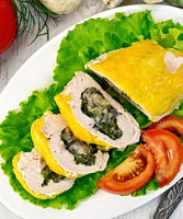 Roll chicken with spinach and tomatoes on board