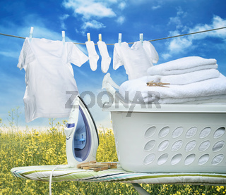Iron on ironing board with basket