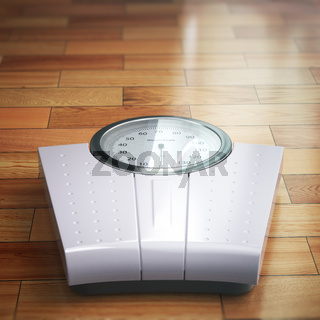 Weight scale on the wooden floor. Space for text.