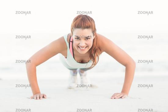 Beautiful brunette doing push ups