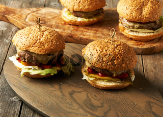 Home made cheeseburgers on wooden table