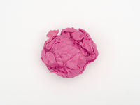 pink crumpled paper ball