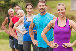 Happy athletic group smiling at camera