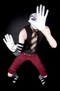 Funny mime in white gloves