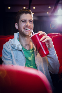 Young man watching a film