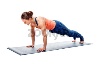 Young fit sporty woman does Hatha yoga plank asana