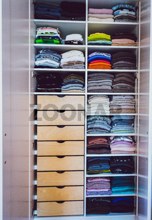 wardrobe with colorful clothes