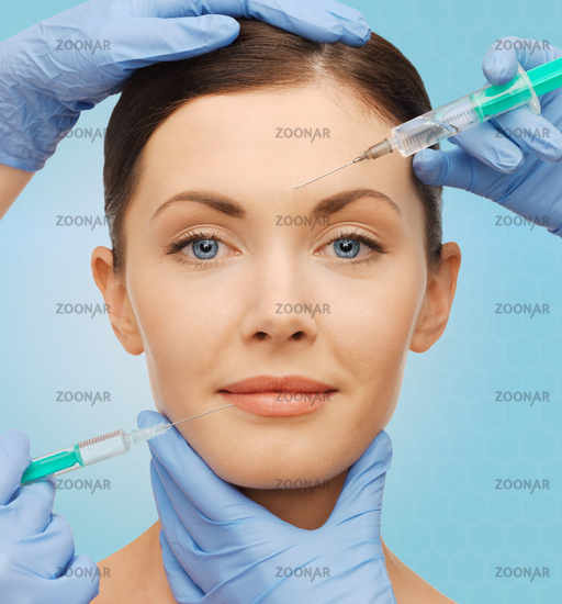 woman face and surgeon hands with syringes