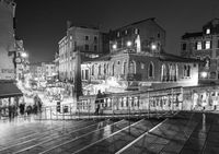 Night market with people and tourists crossing bridge in black and white, Venice, Venezia, Italy, Eu
