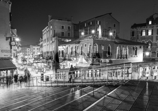 Night market with people and tourists crossing bridge in black and white, Venice, Venezia, Italy, Europe