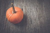 Pumpkin on Rustic Wood Background with Instagram Style Filter