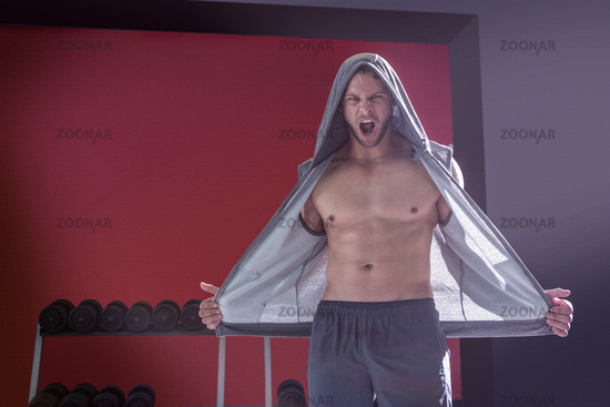 Portrait of muscular man screaming