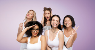 group of happy women in white underwear having fun