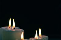 Candles against black background