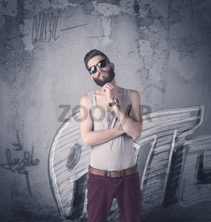Fashion model standing at graffiti wall