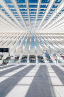 Modern railway station with transparent ceiling and blue sky