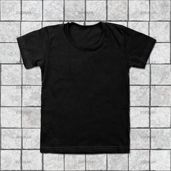 Black blank t-shirt on tile background