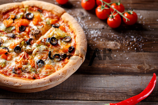 Vegeterian pizza with mushrooms and olives