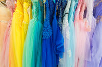ladies evening dresses of different colors at shop