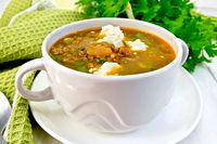 Soup lentil with spinach and feta on board