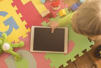 Toddler grabbing tablet