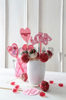 Cake pops with decorations on kitchen table