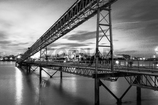Industrial structure on the River Thames in black and white, London, United Kingdom