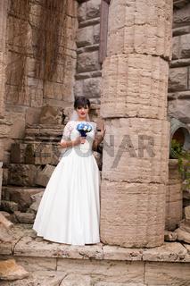 Brunette bride in white dress