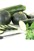 mixed Zucchini with parsley and knife