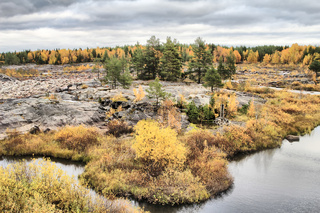 Exceptional view of the dry rocky riverbed and Northern autumn