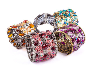 Colorful bracelets stone on white background