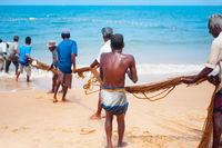 Fishermen at teamwork. Sri Lanka