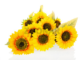 Composition from bright artificial sunflowers isolated on white background.