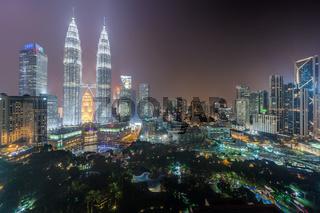 Panorama of Petronas Twin Towers and Kuala Lumpur city park by night